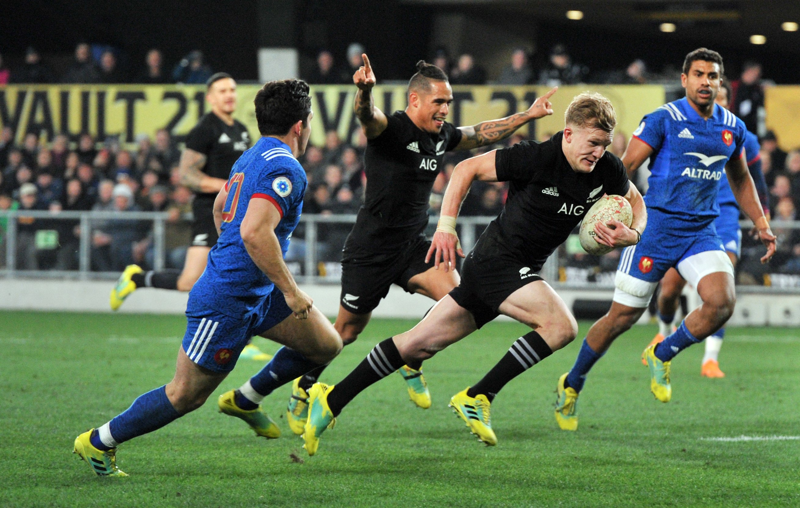 All Black first five Damian McKenzie heads for the tryline in the test against France in Dunedin...