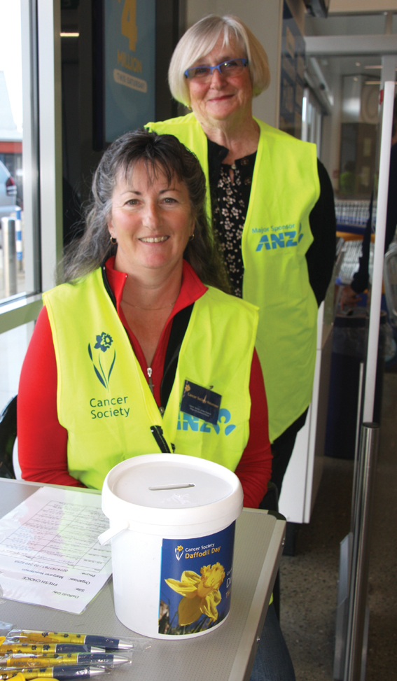 Volunteers Jo Wilson and Agnes Harvey (standing) manning the station at Fresh Choice Te Anau....