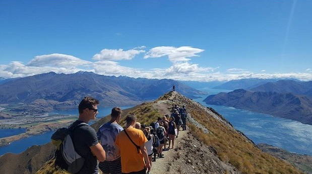 """This image. posted on Reddit and captioned the """"social media queue"""", shows a long line of hikers,..."""