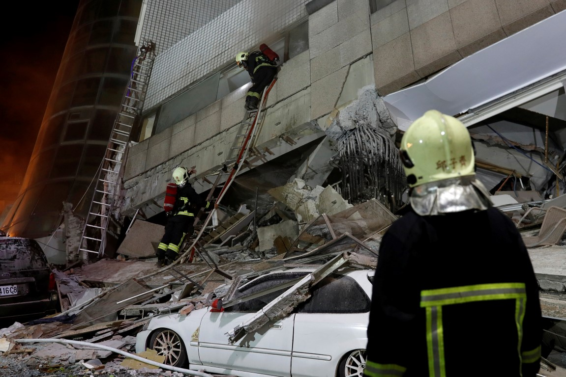 A fireman works at a collapsed building after the earthquake hit Hualien. Photo Reuters