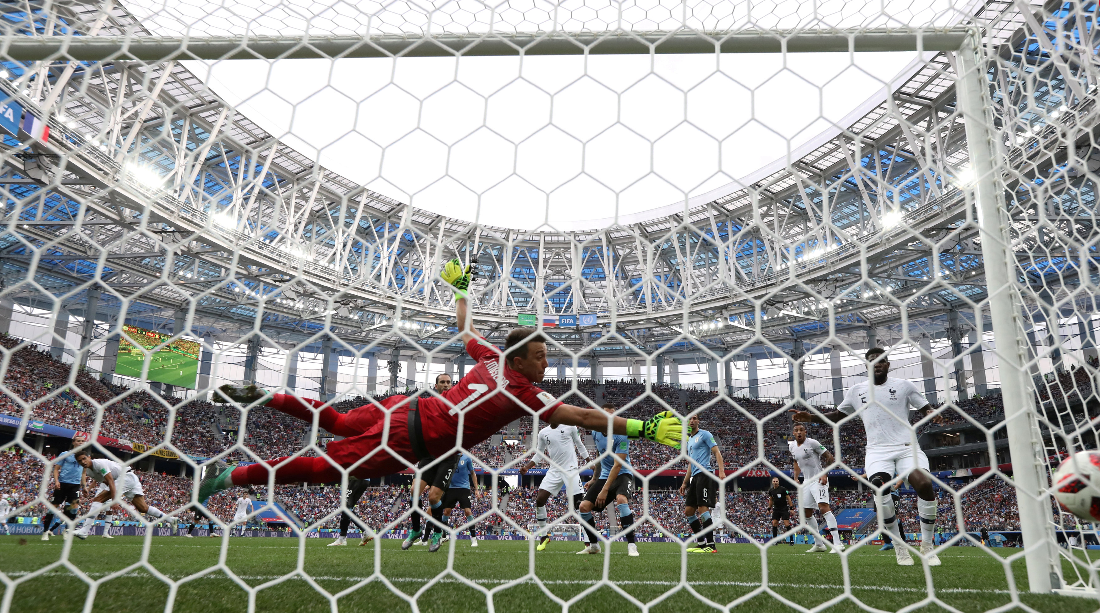 France's Raphael Varane scores their first goal. Photo: Reuters