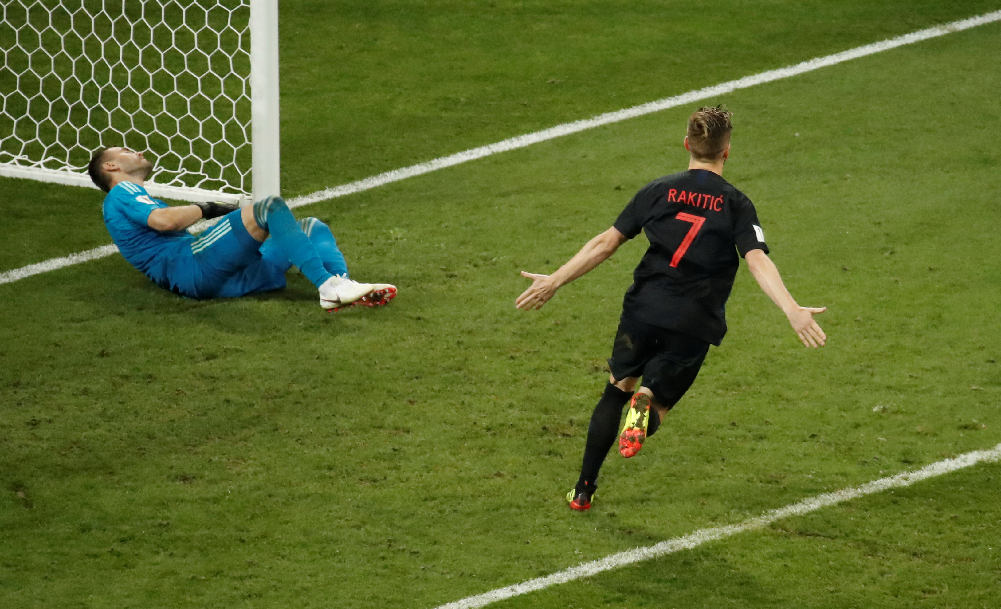 Croatia's Ivan Rakitic celebrates scoring the winning penalty in the shootout. Photo: Reuters