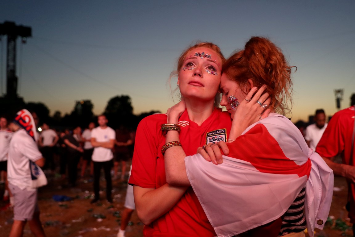 England fans react after watching the match at an event in Hyde Park, London. Photo: Reuters