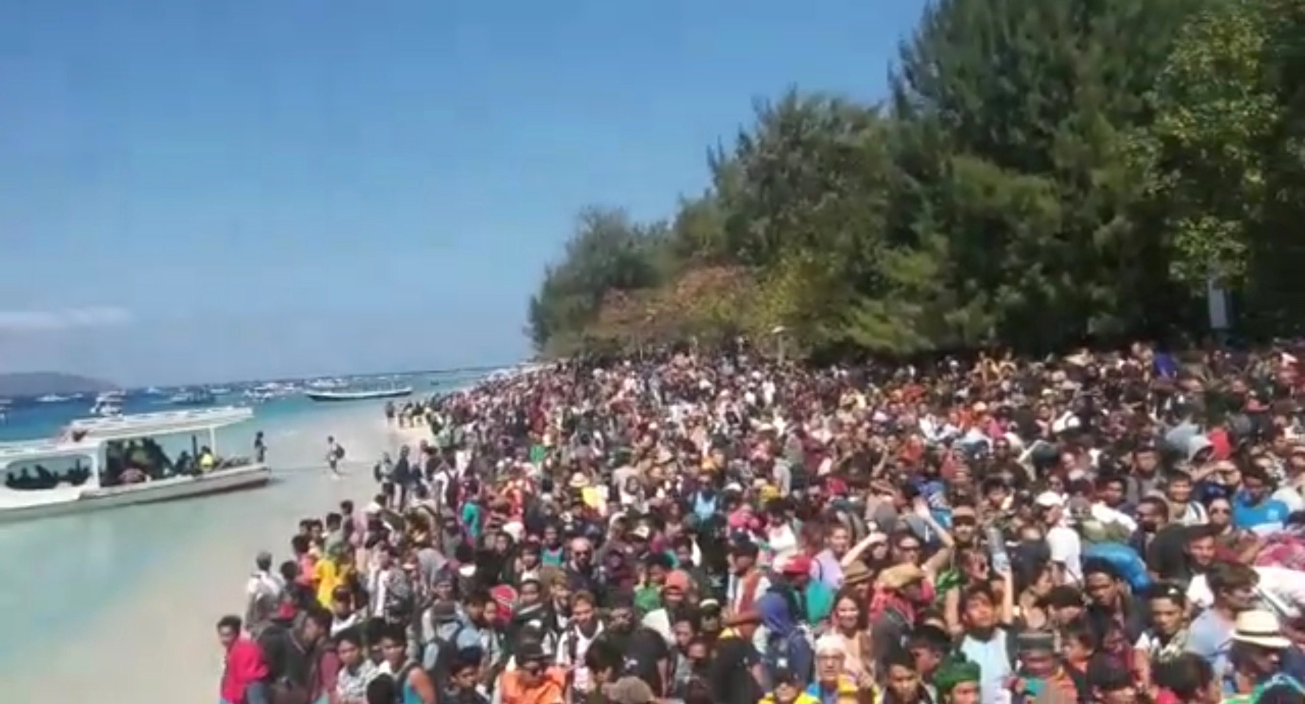 People crowd on the shore as they attempt to leave the Gili Islands after the quake in Lombok....