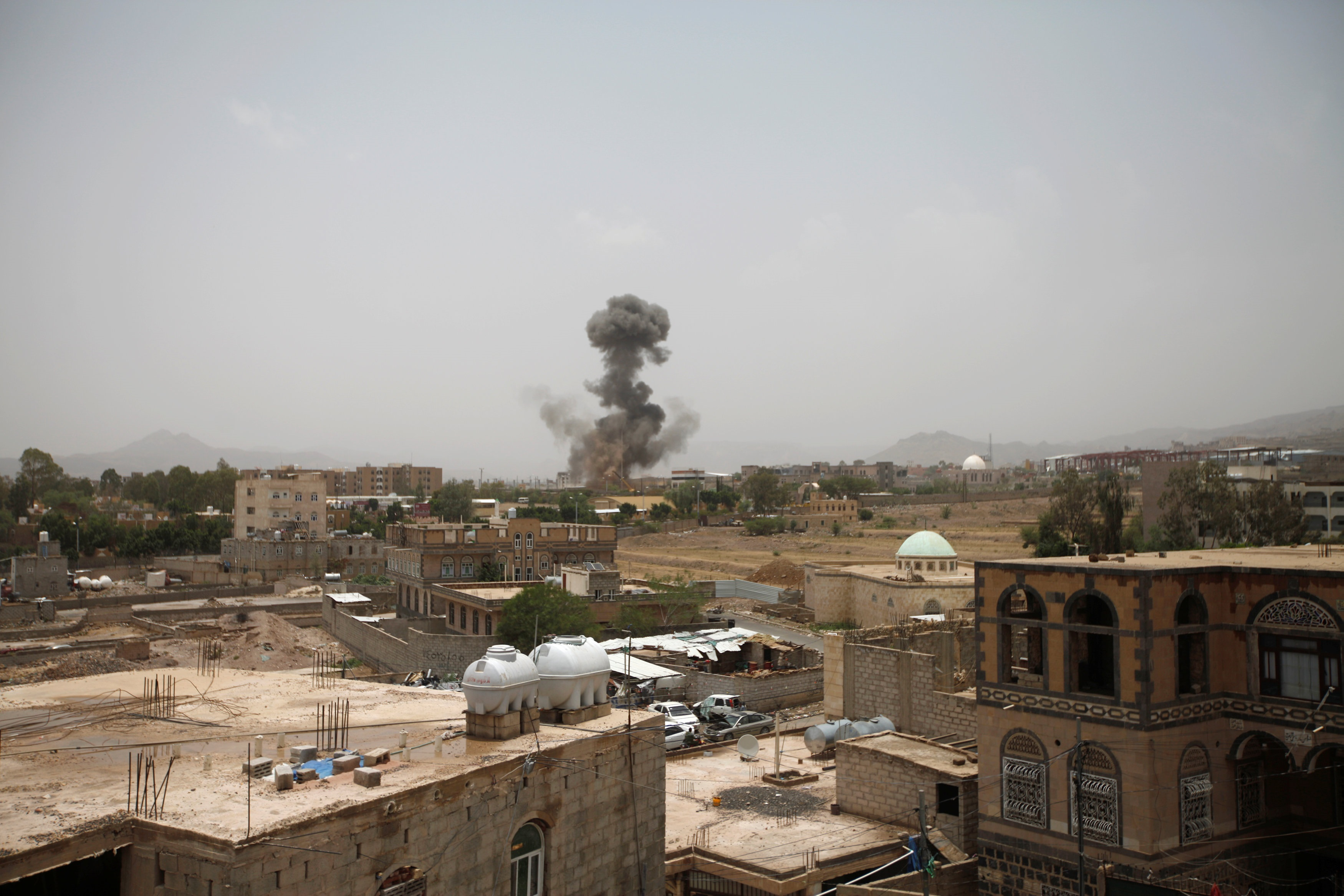 Smoke rises after an airstrike in Sanaa. Photo: Reuters