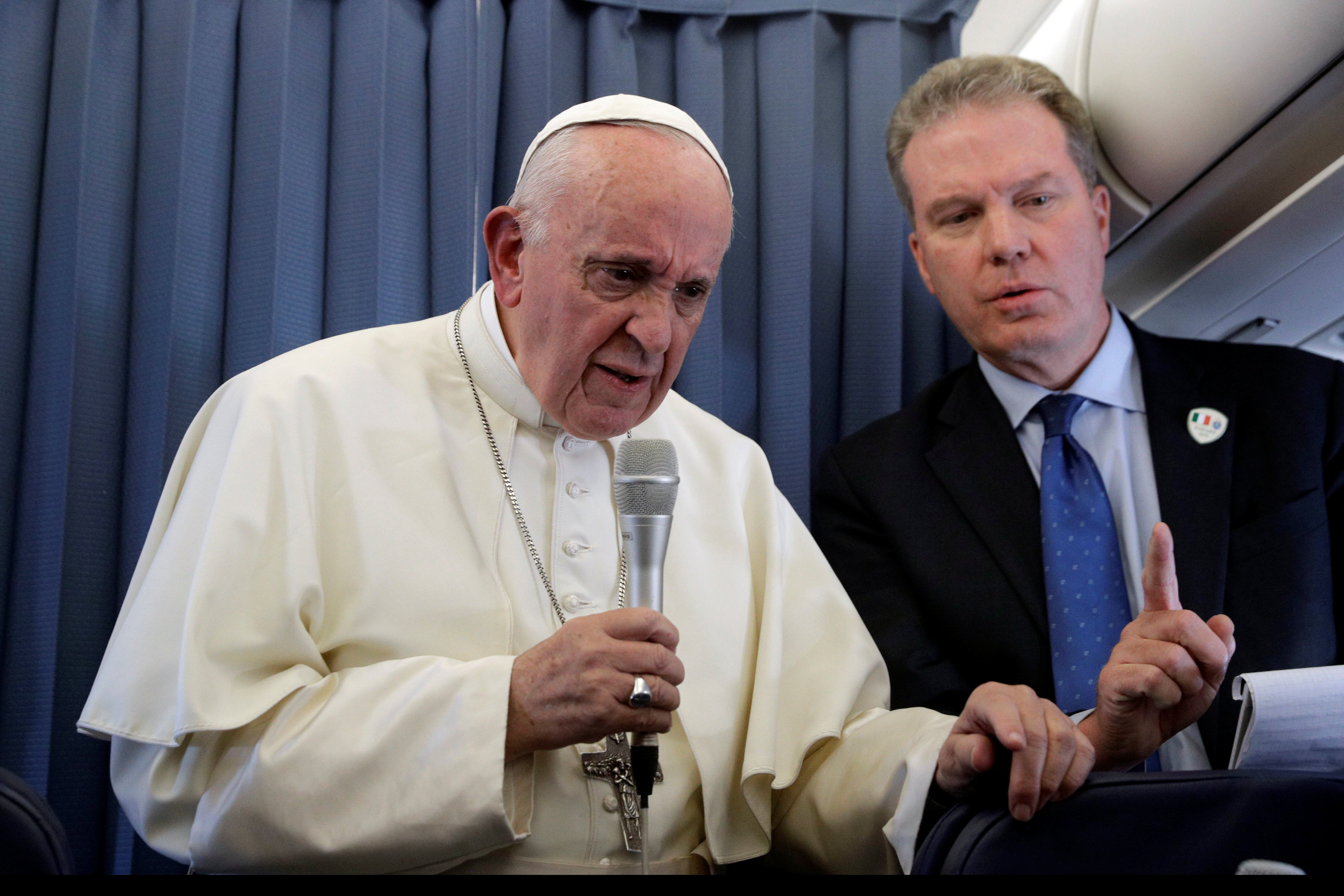 Pope Francis speaks with the media during his flight back from a trip in Dublin. Photo: Reuters