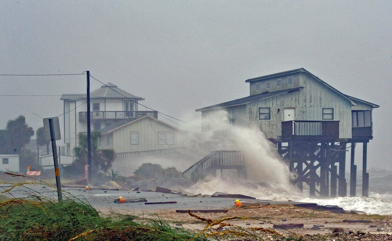 Waves crash on stilt houses along the shore at Alligator Point in Franklin County, Florida. Photo...