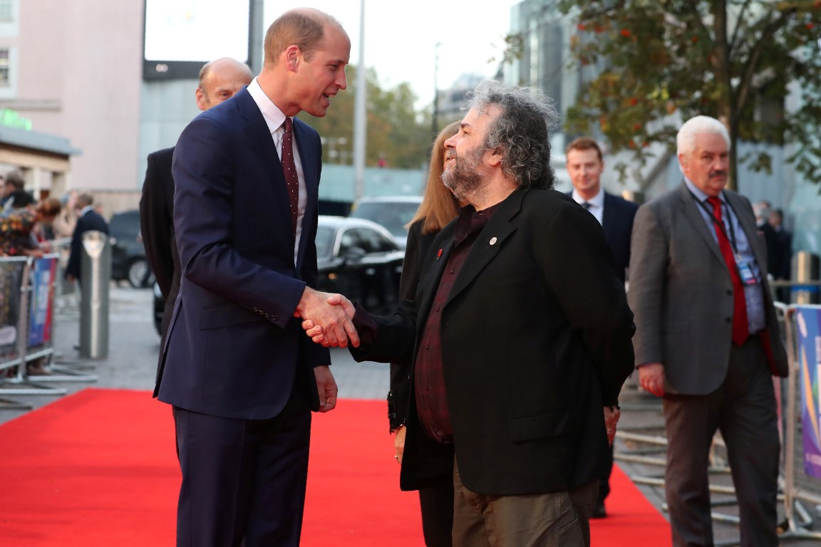 """Prince William shakes hands with Peter Jackson at the world premiere of """"They Shall Not Grow Old""""..."""