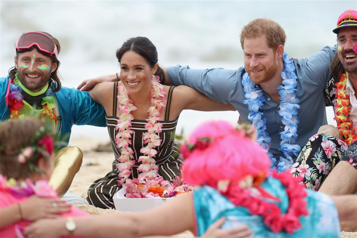 Prince Harry and Meghan Markle take part in a group hug with members of OneWave, an awareness...