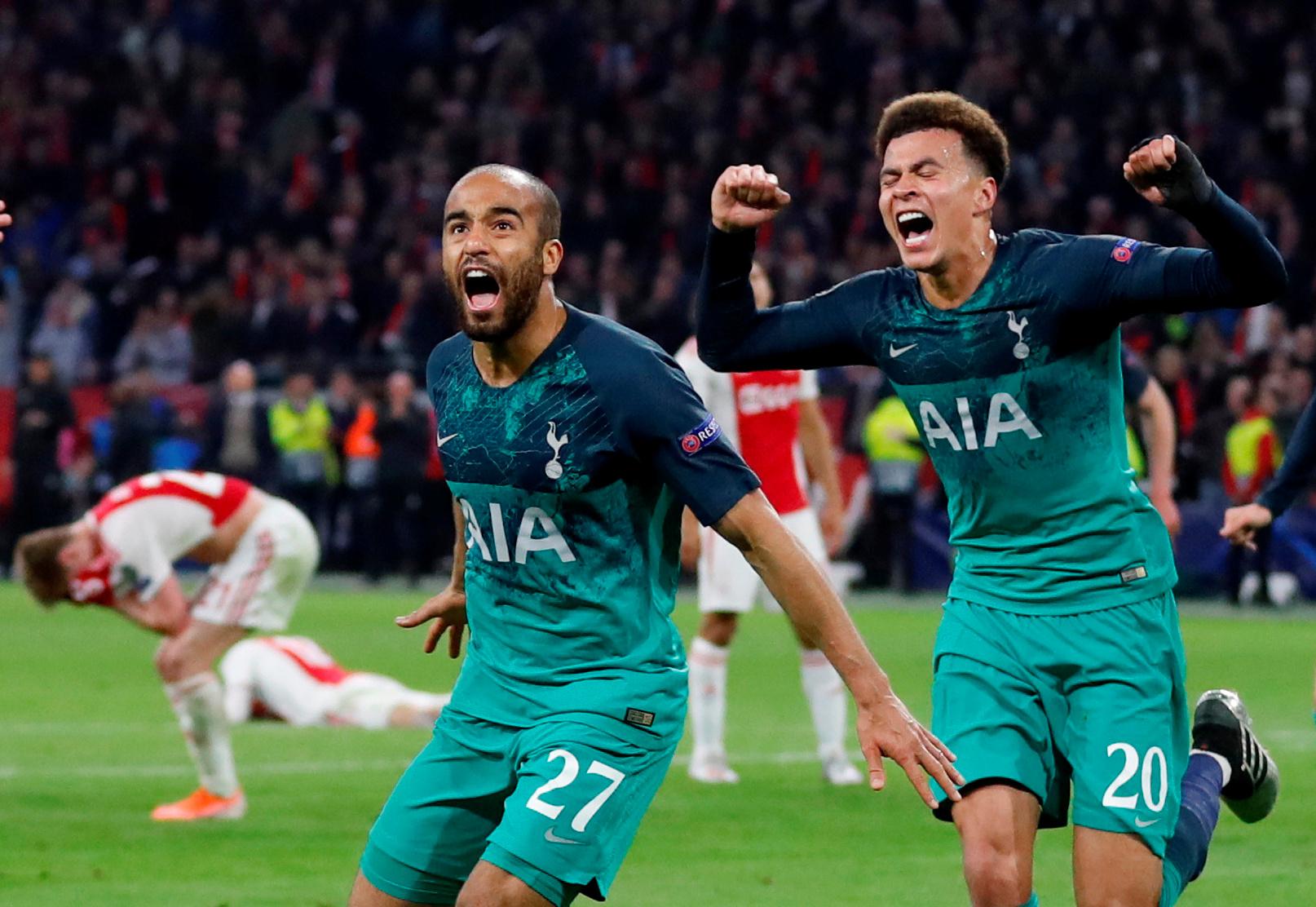 Tottenham's Lucas Moura (centre) celebrates scoring their third goal with Dele Alli. Photo:...