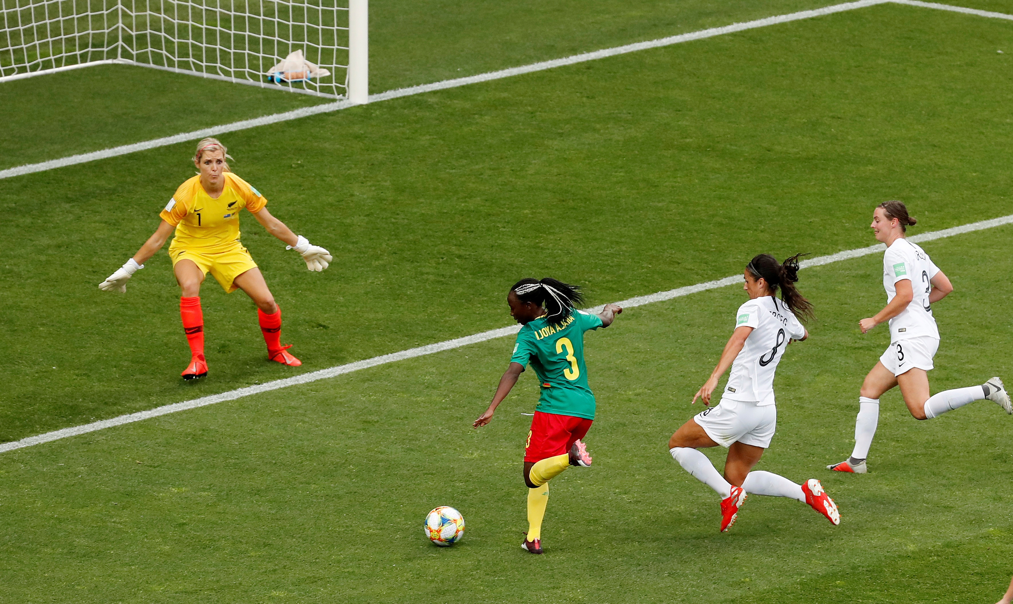 Cameroon's Ajara Nchout scoring their first goal. Photo: Reuters