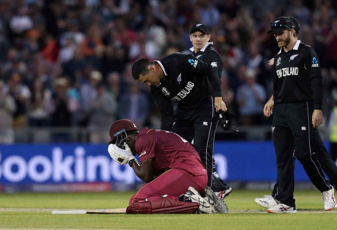 New Zealand players try to console Carlos Brathwaite after his dismissal. Photo: Reuters