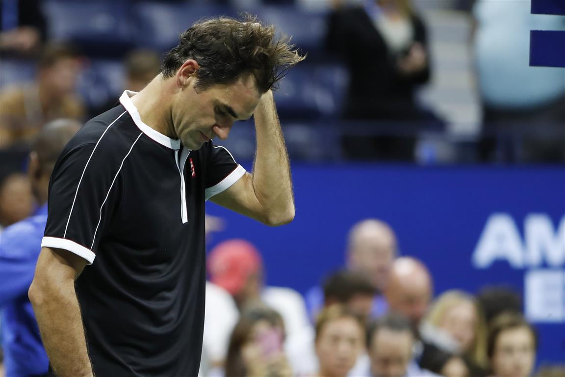 Roger Federer prepares to leave the court after the match. Photo: Geoff Burke-USA TODAY Sports