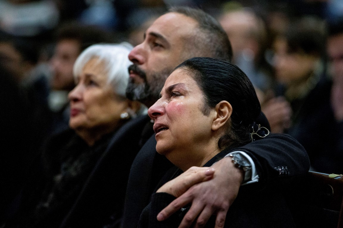 Mourners in Toronto, Canada, attend a memorial service for the victims after the plane was shot...