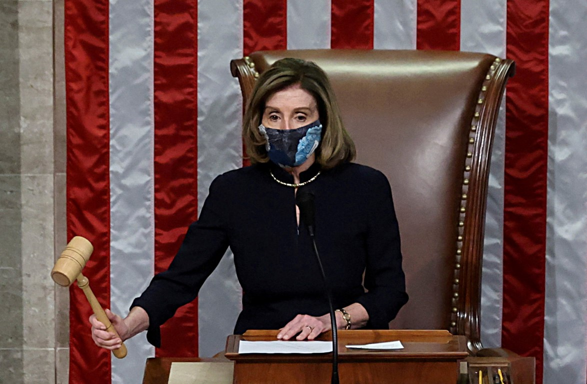 US House Speaker Nancy Pelosi presides over the vote to impeach President Donald Trump, on the...