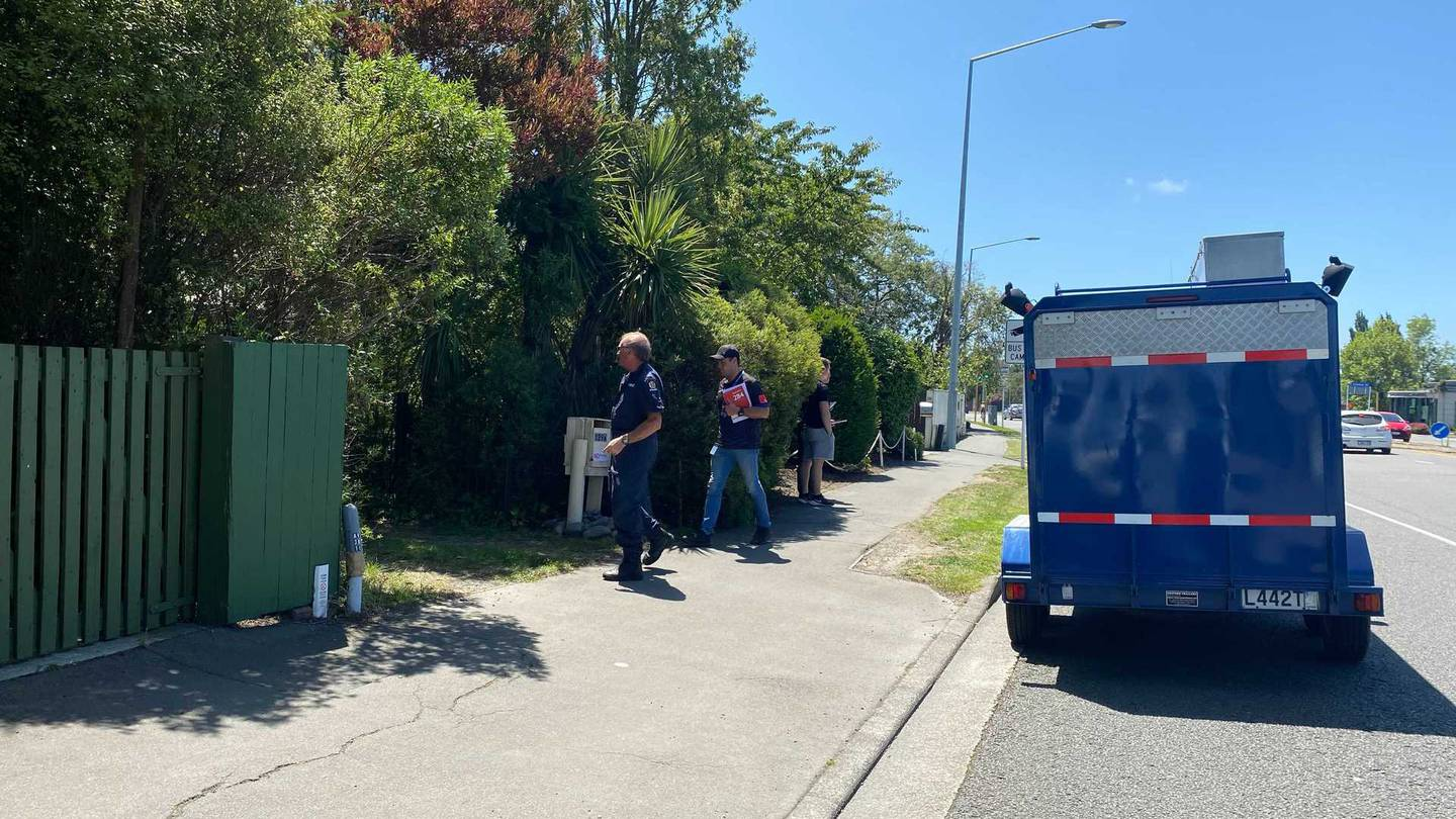 Police at a property in Papanui where a body has been found. Photo: NZ Herald