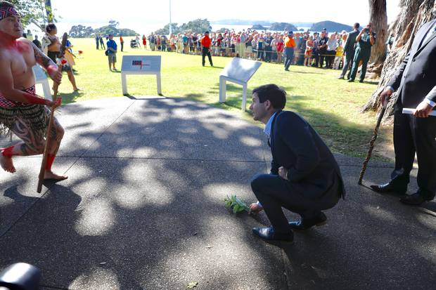 Clarke Gayford accepts the challenge as the Government is welcomed to Waitangi. Photo: NZ Herald