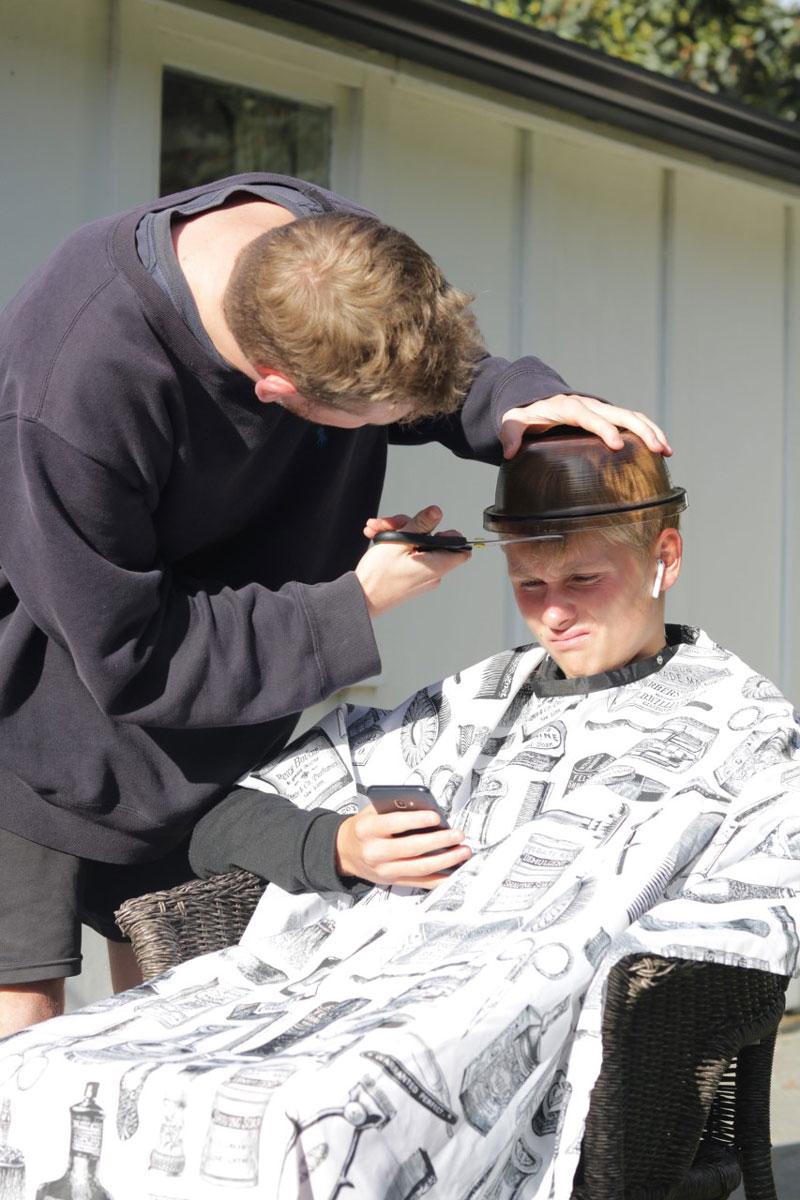 Ben Sapsford cuts his brother Josh's hair.