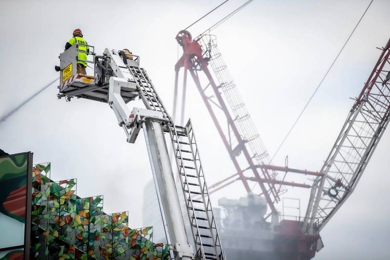 Fire crews are continuing to dampen down hotspots on Thursday. Photo: NZ Herald