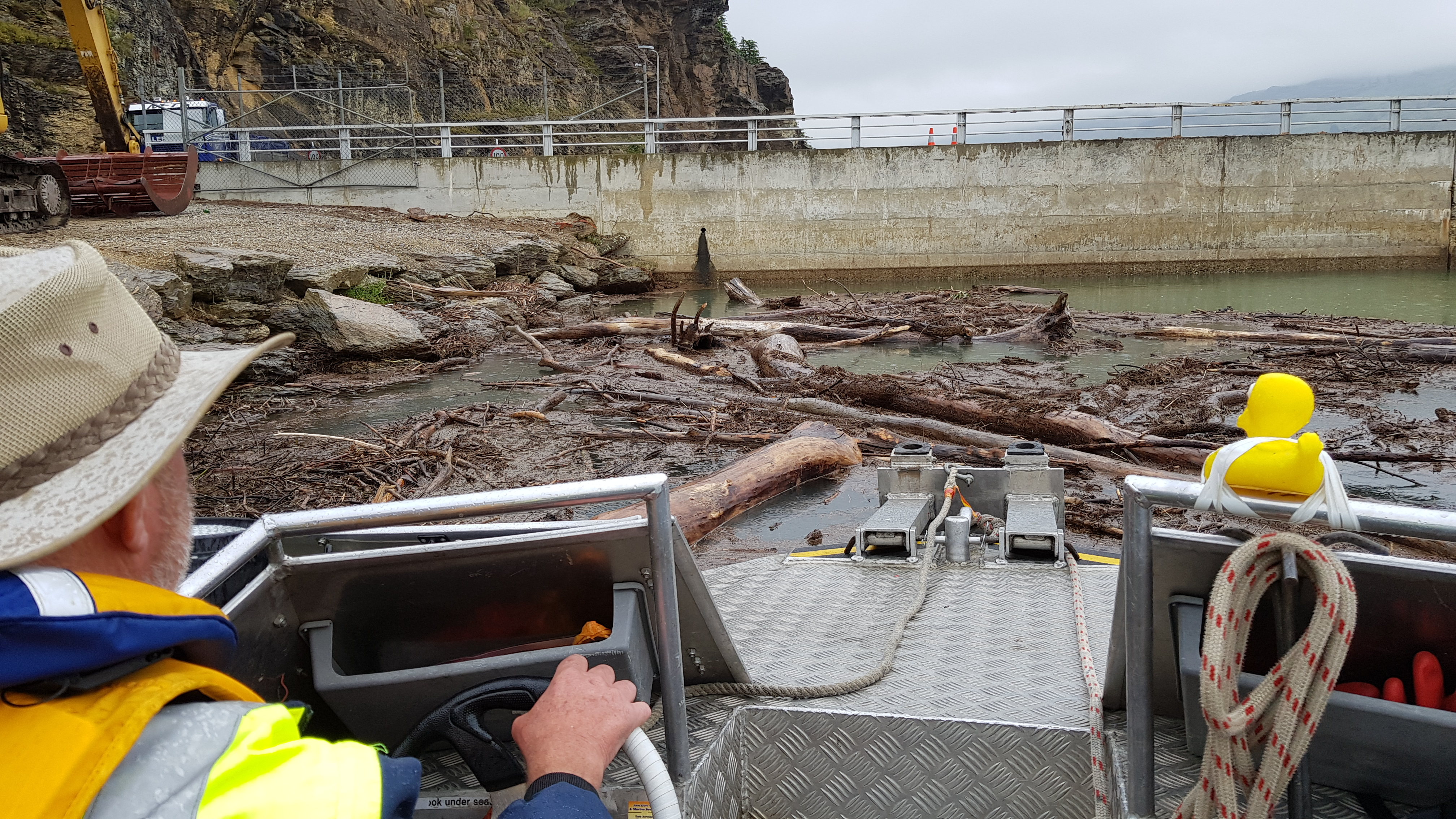 Duck number 424 and boat driver Neil Whitford look over the recent driftwood clearing operation...