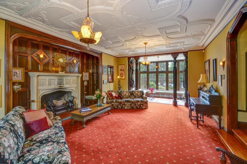"The formal lounge has a large fireplace in a panelled recess. ""It throws out an amazing heat, but..."