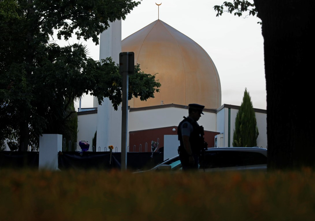 A police officer stands guard in front of the Al Noor mosque in Christchurch. Photo: AP