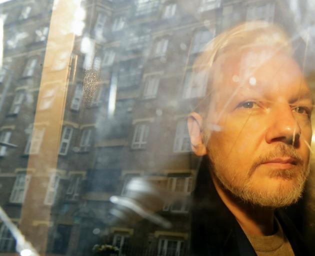 Julian Assange is serving a 50-week sentence in a London jail for skipping bail. Photo: AP