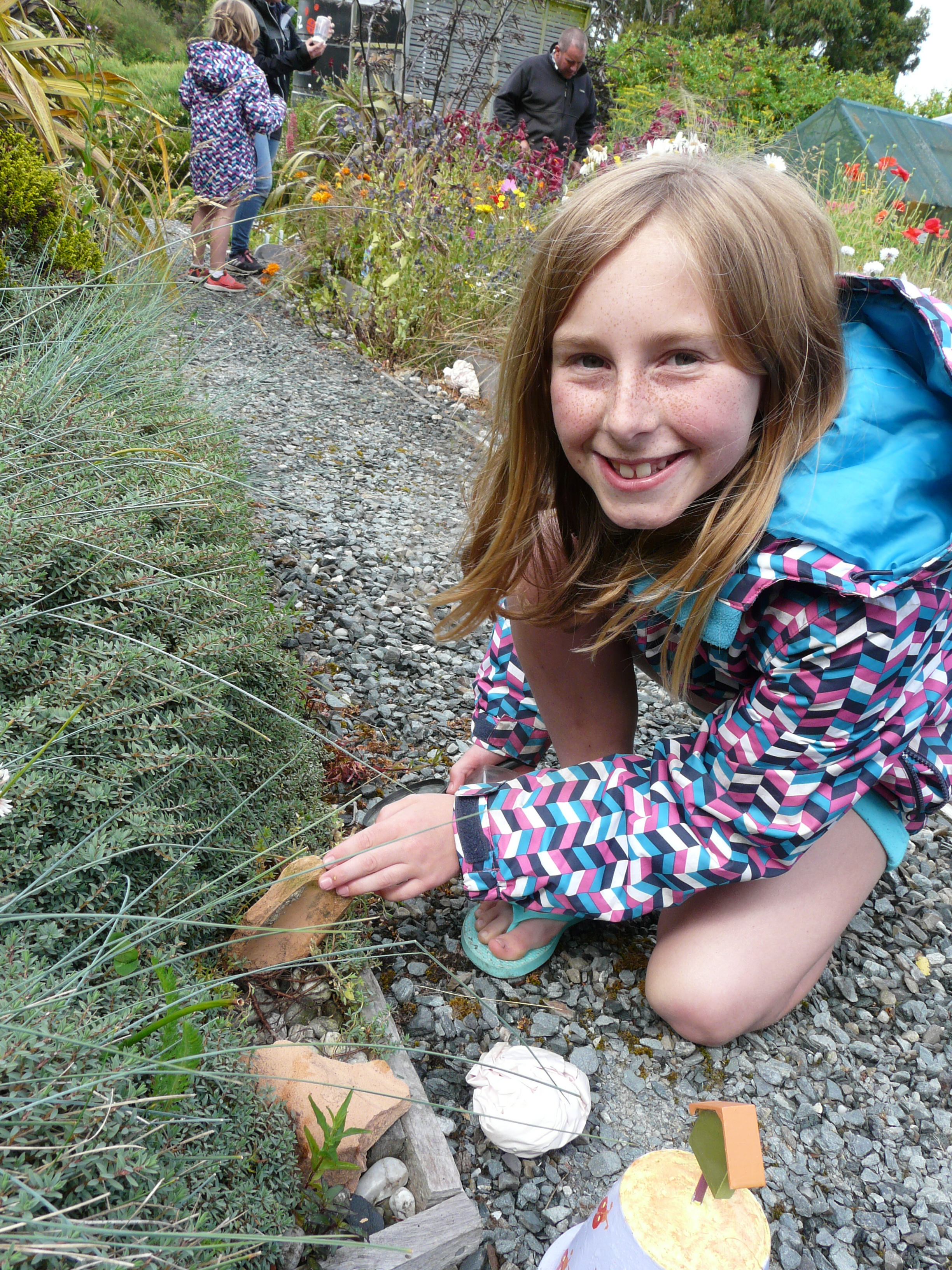 Brooklyn SMith (10), of Balclutha, fossicks for bugs at Earthlore, Owaka yesterday.