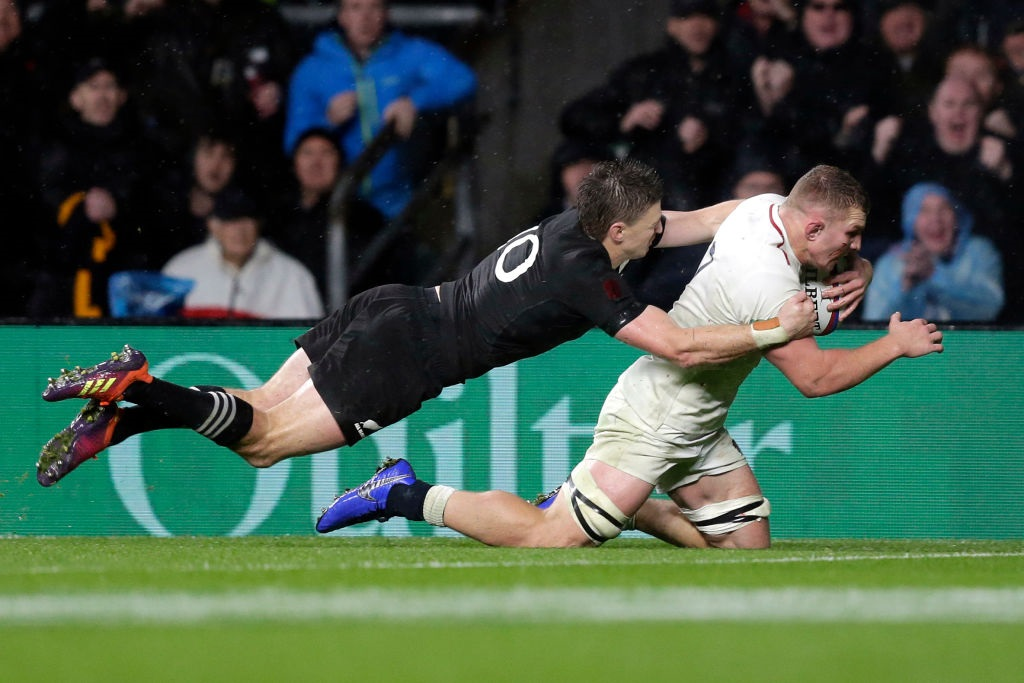 Beauden Barrett tackles Sam Underhill as he scores a try that was later disallowed. Photo: Getty...