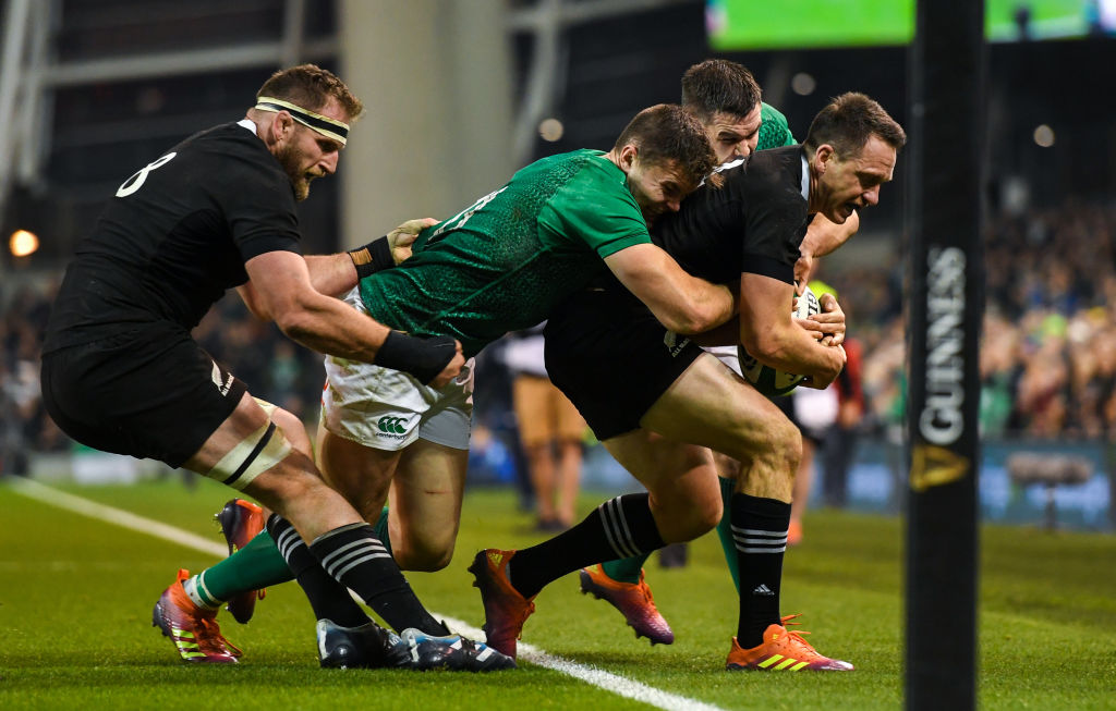 All Black Ben Smith is forced into touch by IJonathan Sexton and Jacob Stockdale despite the...