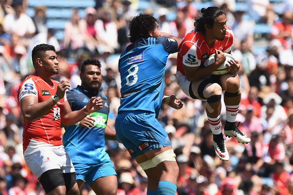 Ryohei Yamanaka of the Sunwolves competes for the ball against Steven Luatua of the Blues. Photo:...