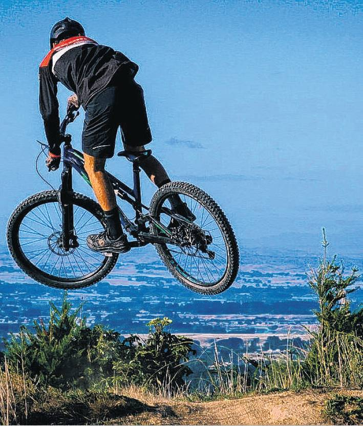A rider enjoys one of the tracks at Arapuke Mountain Bike Park (below).
