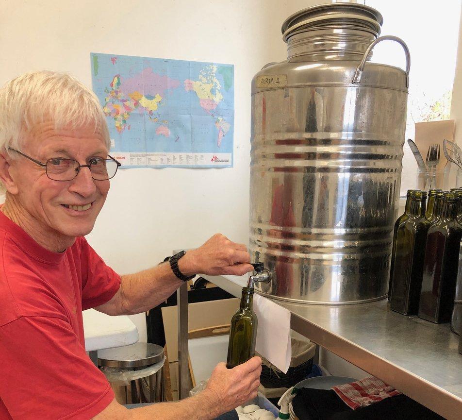 Tony Lawrence bottles Aurum's olive oil. PHOTO: CHARMIAN SMITH