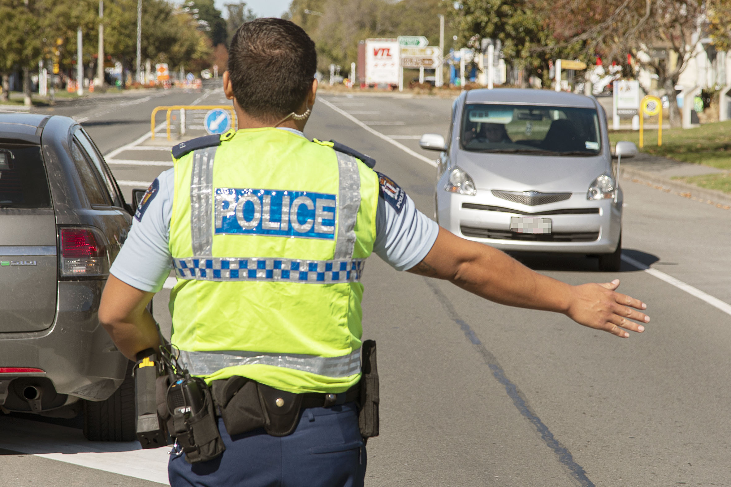 Police stop motorists at a checkpoint in  Amberley. Photo: Geoff Sloan