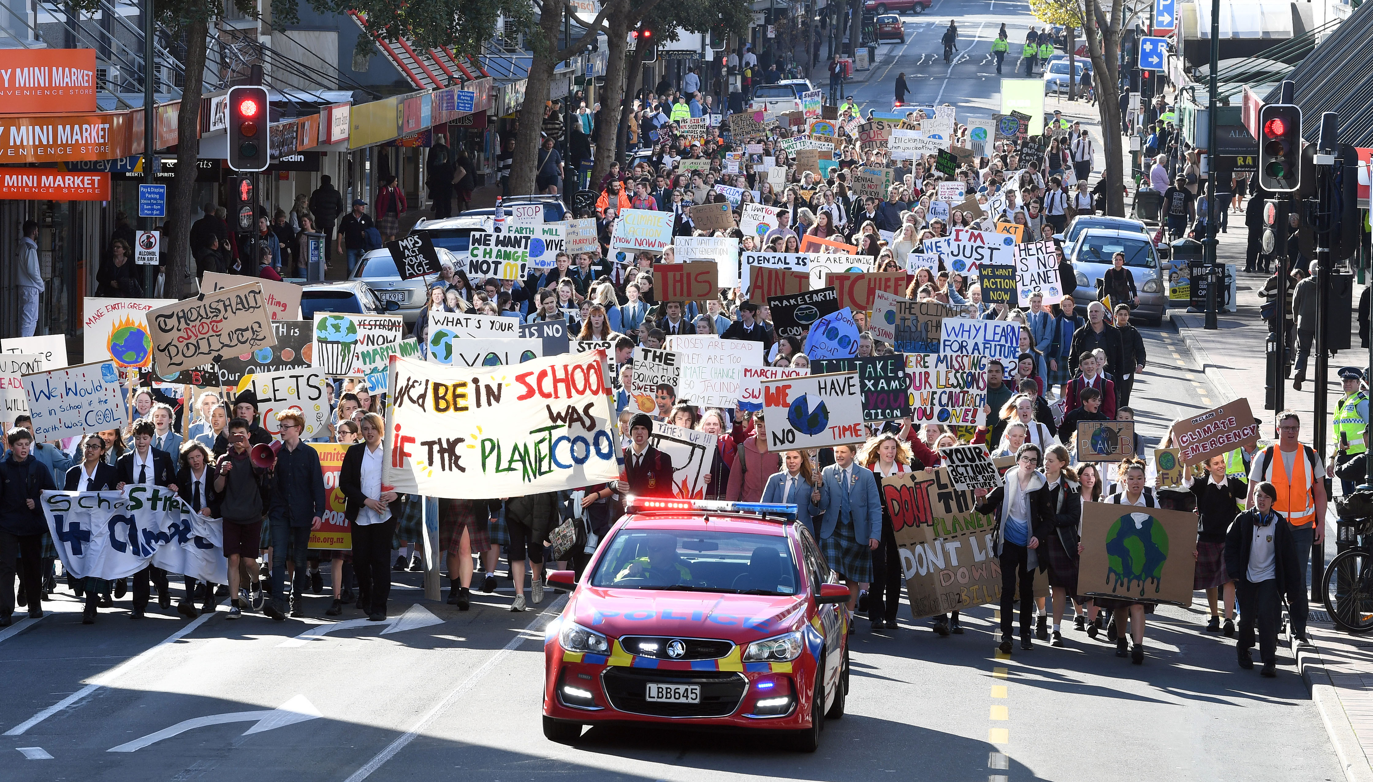 Students marching along George St towards the Octagon this afternoon. Photo: Stephen Jaquiery
