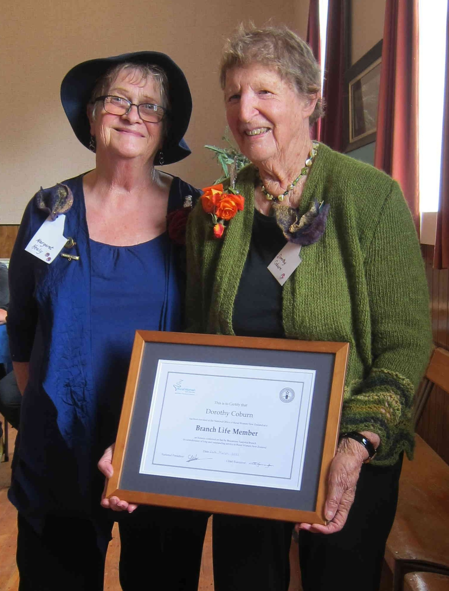 Beaumont-Tuapeka Rural Women convener Margaret Healy (left) presents a branch life membership to...