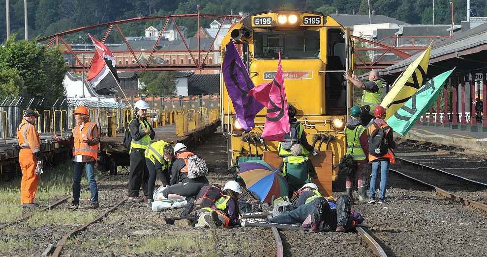 Several of the protesters have locked themselves to the train tracks at Dunedin Railway Station....