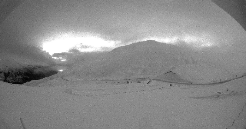 The Crown Range blanketed by snow on Thursday night. Photo: MetService