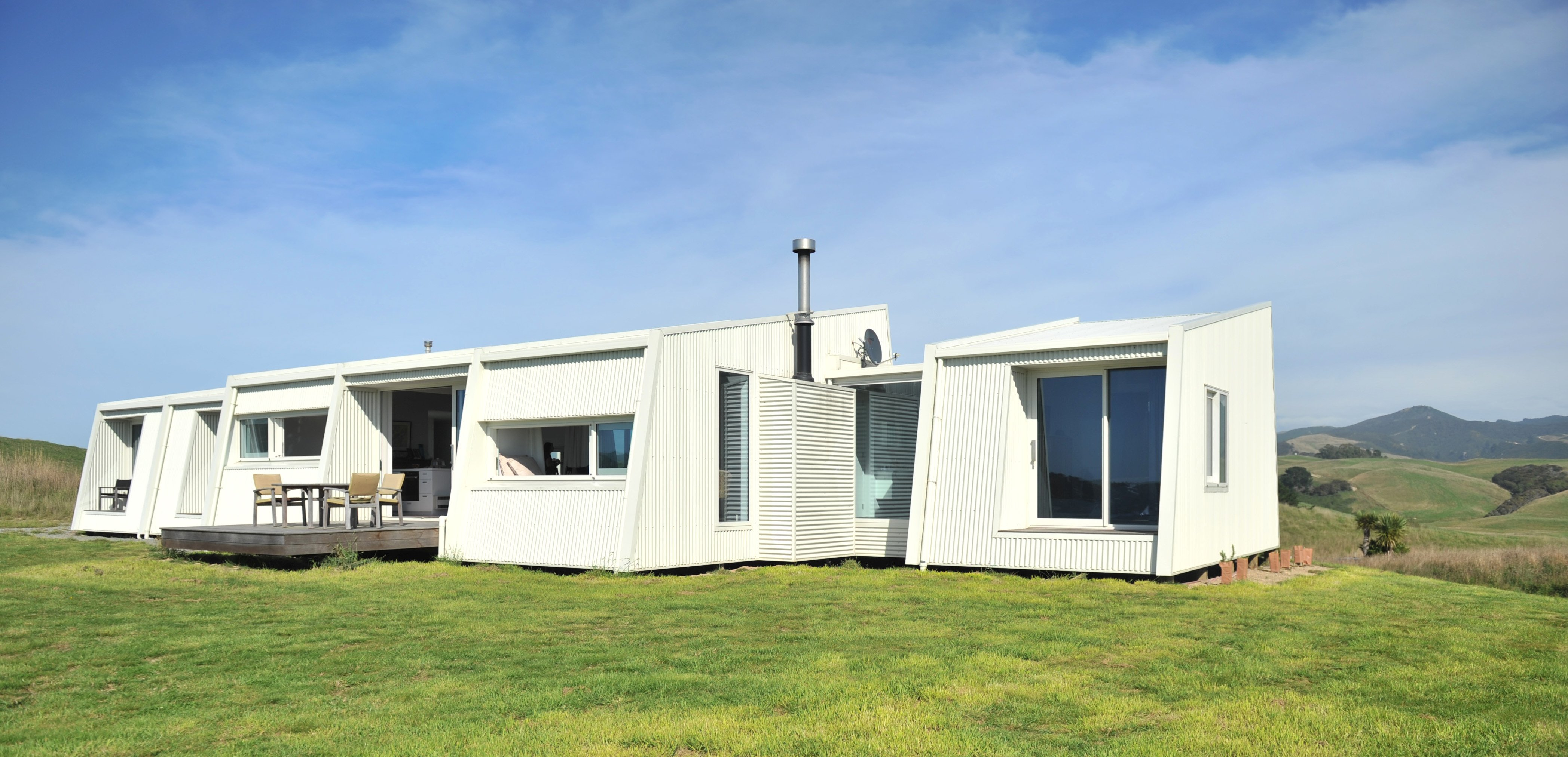 This house is built across its Moeraki site to capitalise on the views. The exterior is painted a...