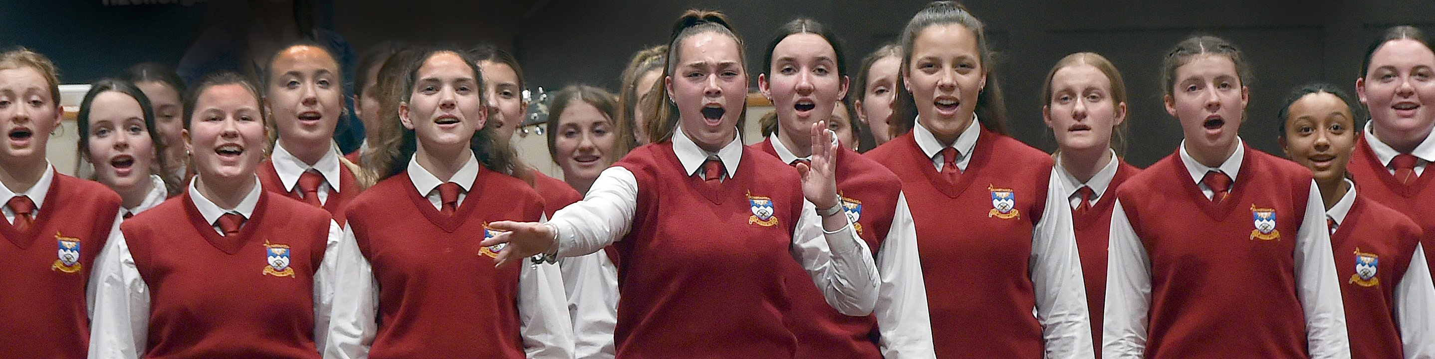 Aja Tate-Bell (17) leads the Dunstan High School choir at the Big Sing 2021 regional competition...