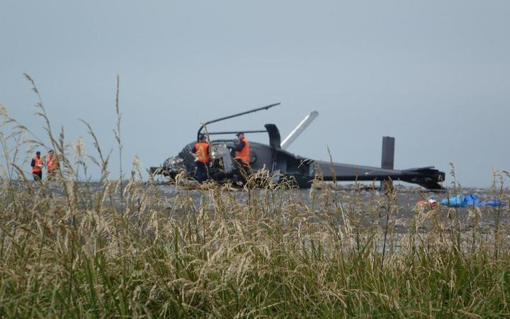 Accident inspectors at the helicopter crash site in Kekerengu. Photo: RNZ / Tracy Neal