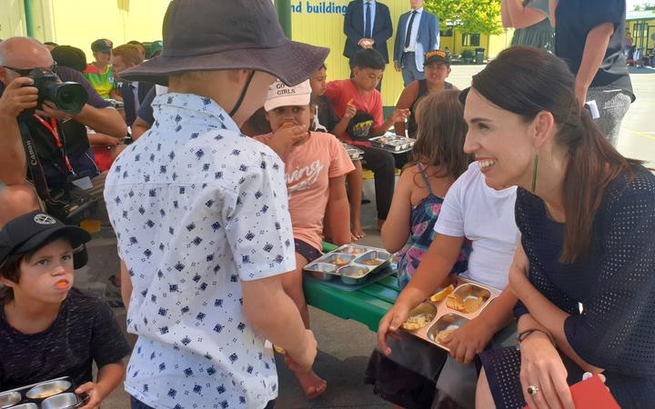 Prime Minister Jacinda Ardern talks to pupils receiving a free lunch at Flaxmere Primary School....