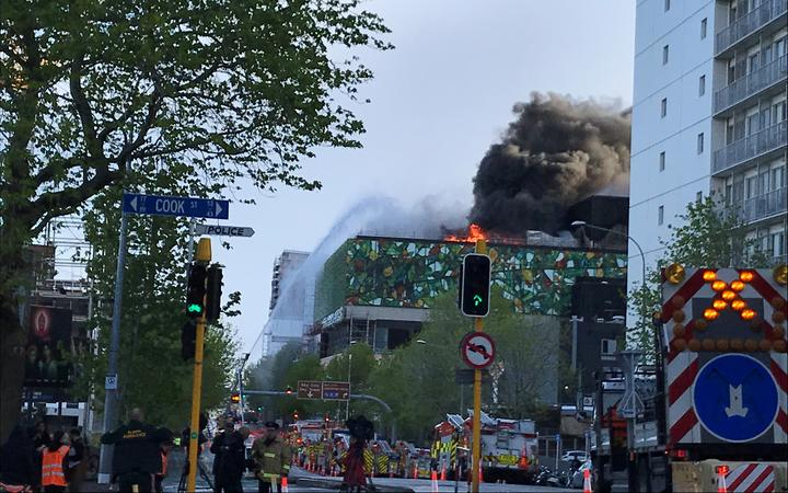 Flames and smoke were still coming from the roof of the convention centre this morning. Photo: RNZ