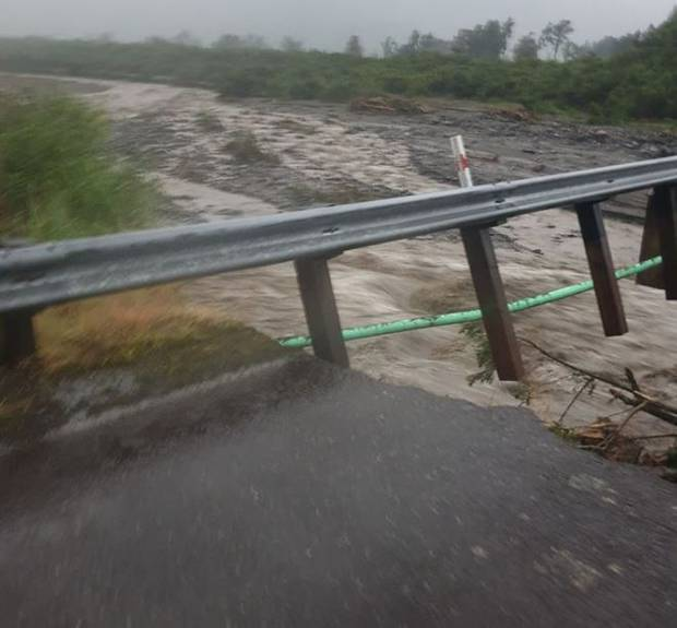A swollen river under the bridge near Te Taho. Photo: Facebook via NZ Herald