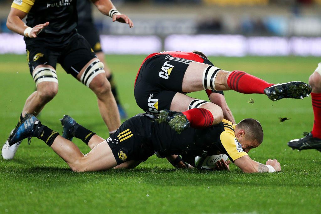 TJ Perenara of the Hurricanes is tackled by Matt Todd of the Crusaders. Photo: Getty