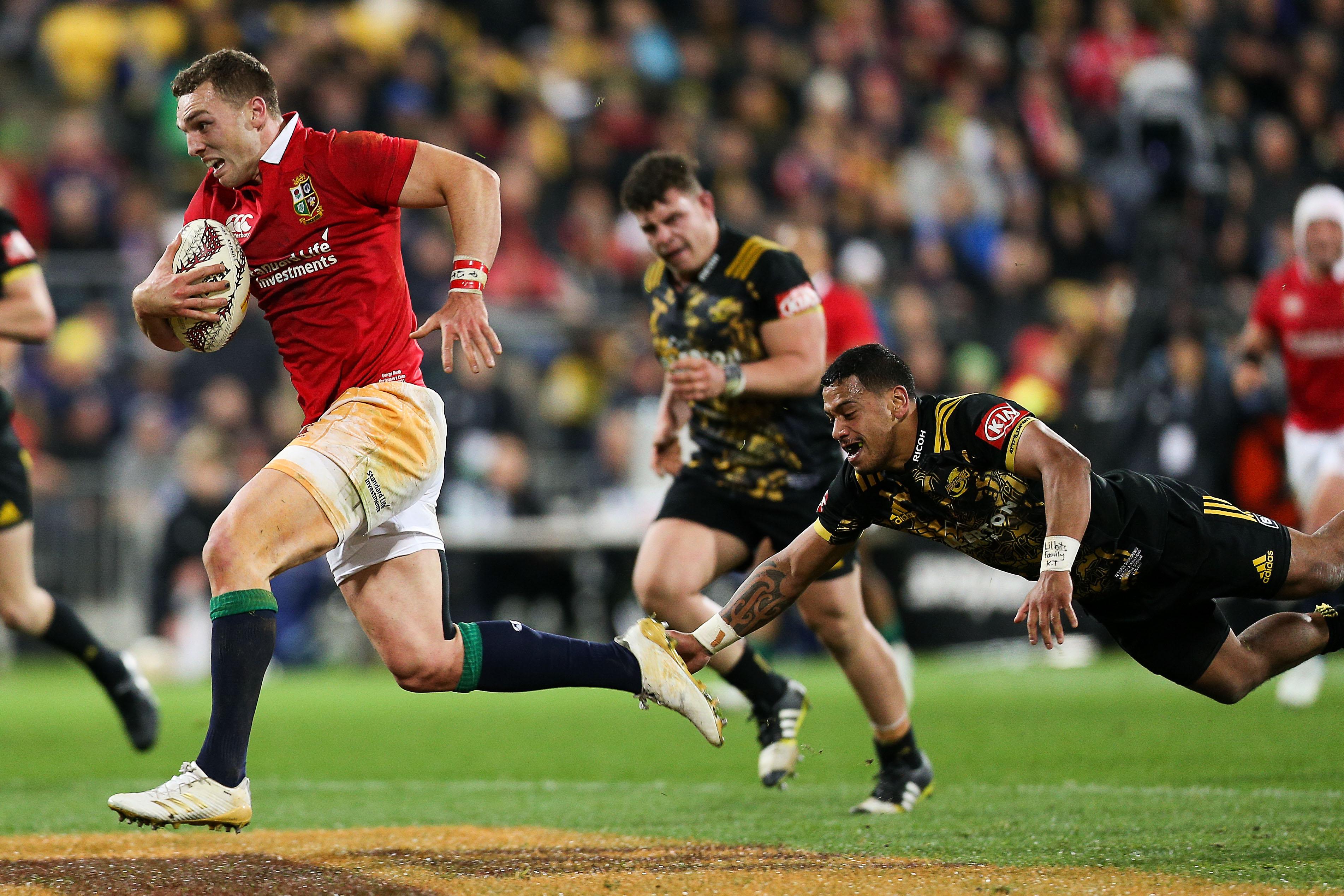 George North of the Lions beats the tackle of Te Toiroa Tahuriorangi of the Hurricanes to break...