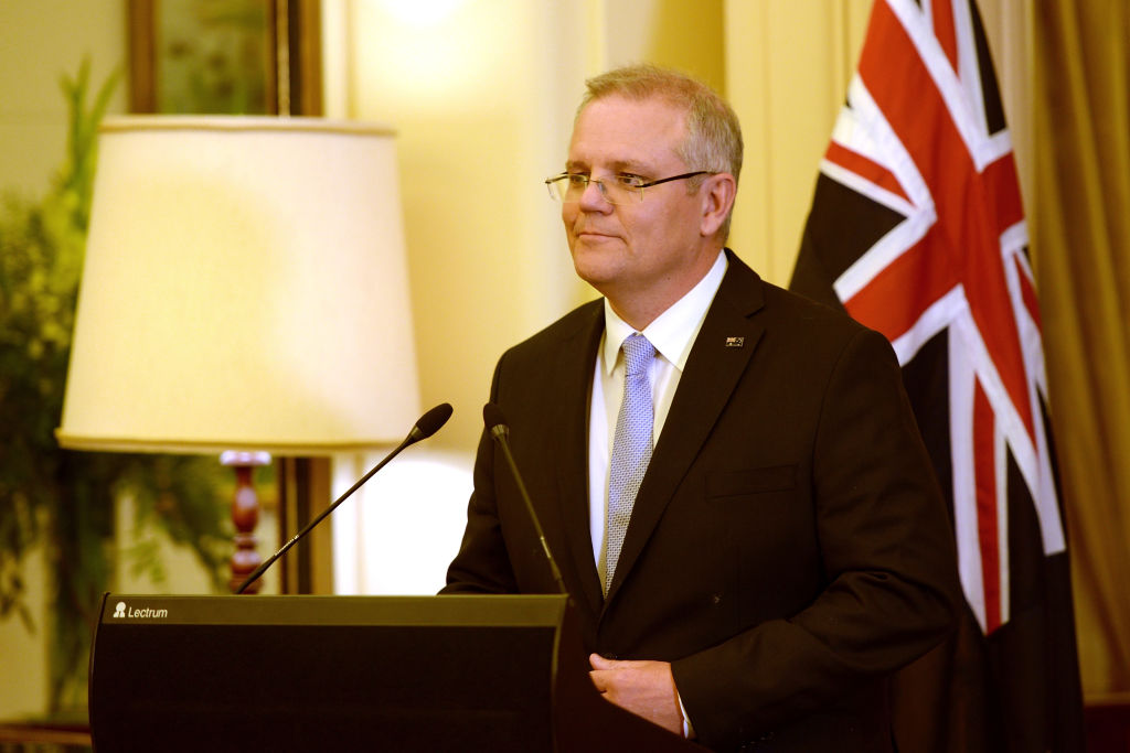 Prime Minister Scott Morrison talks after being sworn in  at Government House. Photo: Getty Images