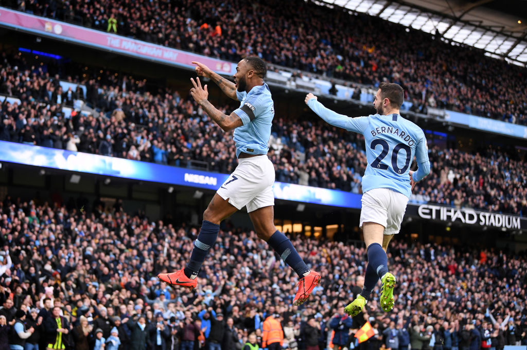 Manchester City's Raheem Sterling celebrates with teammate Bernardo Silva after scoring his team...