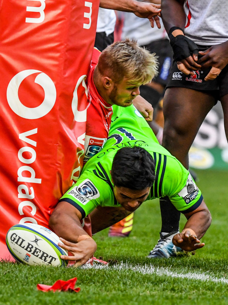 Josh Ioane inches around the post to score a try for the Highlanders at Ellis Park. Photo: Getty...