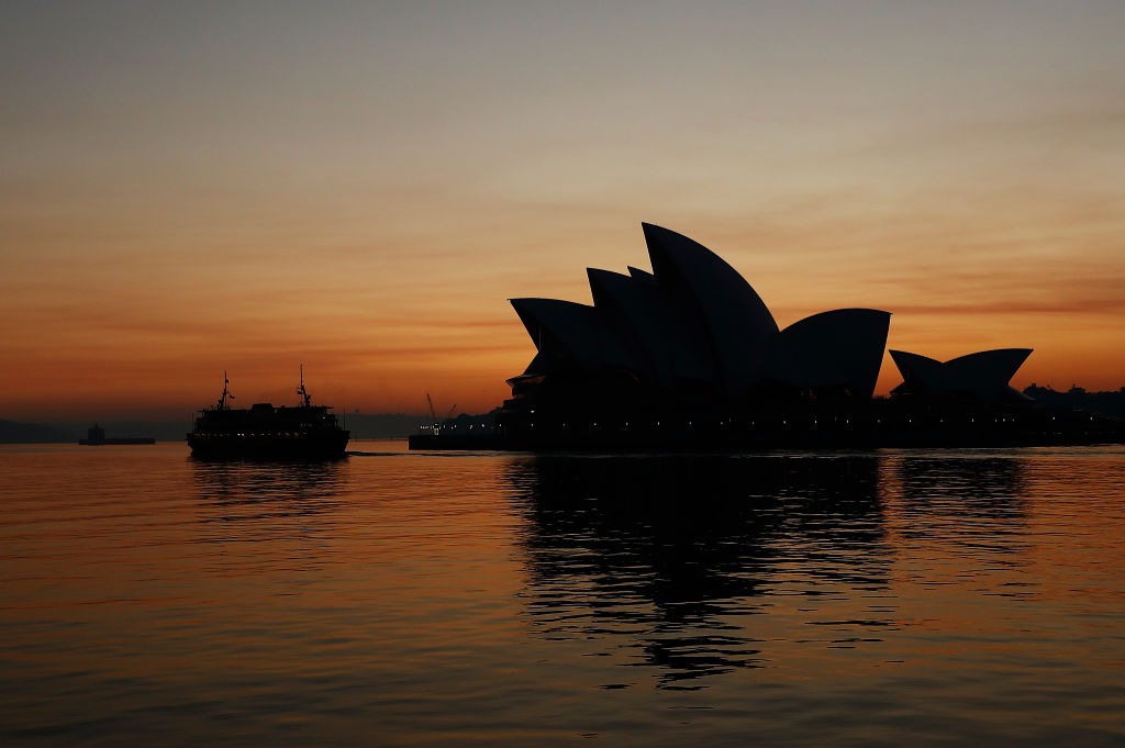 A smoky sunrise behind the Sydney Opera House on Tuesday morning. Photo: Getty